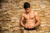 Attractive and muscular shirtless young man — Stock Photo