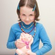 Girl child holding a piggy bank — Stock Photo #67500553