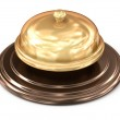 Golden bell over white — Stock Photo #55568447