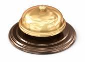 Golden bell over white — Stock Photo