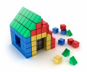 Construction of house from children's blocks. Isolated on white — Stock Photo