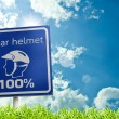 The safety zone sign of wear a helmet for safety on the road on — Stock Photo #68365227
