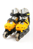 Yellow & Black Colored roller skates isolated on white — Stock Photo