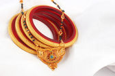 Close-up of a Indian necklace Mangalsutra & Golden Bangles — Stock Photo