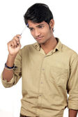 Beautiful Young Indian Boy thinking with pen — Stock Photo