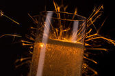 Champagne glass with Ignited Sparkler  — Stock Photo