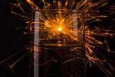 Happy new year firework on a champagne glass — Stock Photo
