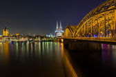 City of cologne at night with Cathedral and bridge — Stock Photo