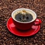 Coffee cup drop impact — Stock Photo #69770679