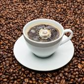 Cup of coffee with a milk drop — Stock Photo