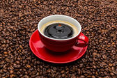 Drop falls in a coffee cup — Stock Photo