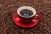 Drop of coffee on beans — Stock Photo