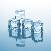 Crystal clear cube of ice — Stock Photo