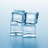 Four ice cubes — Stock Photo