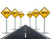Years ahead road signs and road stretches into the distance. — Stock Photo
