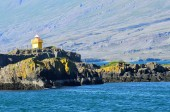 Landscapes of Iceland, lighthouse on the mountain in ocean — Stock Photo