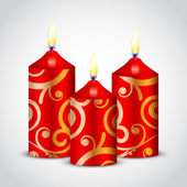 Vector illustration of red candles with gold ornament — Stockvektor