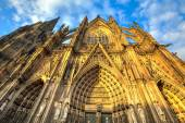 Facade of the Dom church in the city Cologne lit by sun — Stock Photo
