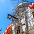 Colonial clock hanging on an old colonial building — Stock Photo #60701391
