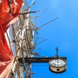 Colonial clock hanging on an old colonial building — Stock Photo #60701405