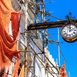 Colonial clock hanging on an old colonial building — Stock Photo #60701411