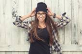 Hipster girl in glasses and black beanie — Stockfoto