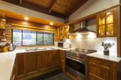 Contemporary wooden kitchen — Stock Photo
