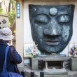 Remains of the Ueno Daibatsu Buddha statue in Ueno Park - Tokyo - Japan — Stock Photo #61088275