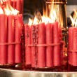 Bundles of Red Prayer Candles — Stock Photo #60089831
