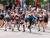Dance Troupe Performs In Parade — Stock Photo