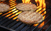 Burgers Cooking On The Grill — Stock Photo