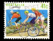 Australia stamp shows cycling — Stock Photo