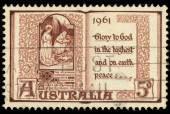 A stamp printed in Australia shows Glory to God in the highest and on earth peace — Stock Photo