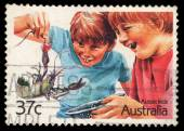 A stamp printed in Australia shows image of Aussie kids — Stock Photo
