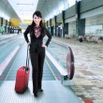 Businesswoman standing on escalator 1 — Stock Photo #51822329