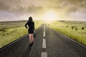Businesswoman standing on the highway road 3 — Stockfoto