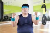 Cheerful fat man in fitness center — Stock Photo