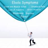 Doctor pulling Ebola symptoms banner — Stock Photo
