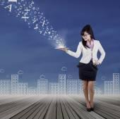 Full length of woman holds digital tablet — Stockfoto