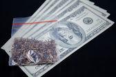 Marijuana packet on US currency — Stock Photo