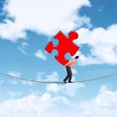 Businessman carrying puzzle on the rope 1 — Stock Photo