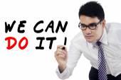 Businessman writes motivation words 2 — 图库照片