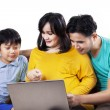 Asian family sitting on couch with laptop — Stock Photo #52825381