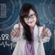 Attractive doctor showing thumbs-up 1 — Stock Photo #52825871