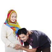Happy islamic family waiting childbirth — Stock Photo