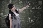 High school student taking self portrait — Stock Photo