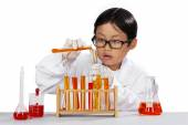 Little boy mixes the chemistry — Stock Photo
