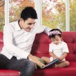 Father and his child reading a book — Stock Photo #53262429