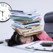 Tired woman with a pile of document — Stock Photo #53264625