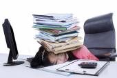 Female accountant with a pile of paperwork — Stock Photo